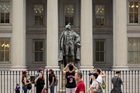 Visitors take photographs outside the U.S. Treasury building in Washington on Aug. 13, 2019. MUST CREDIT: Bloomberg photo by Andrew Harrer.