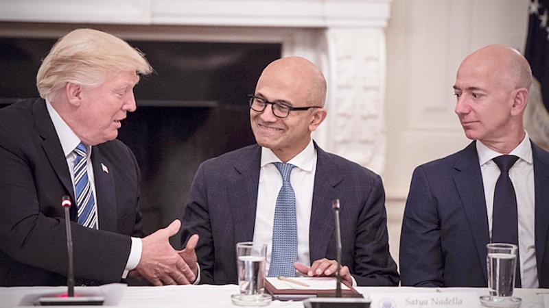 President Trump greets Satya Nadella, chief executive officer of Microsoft, and Jeff Bezos, chief executive officer of Amazon, during an American Technology Council roundtable in 2017. MUST CREDIT: Washington Post photo by Jabin Botsford.