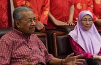 Prime Minister Tun Dr Mahathir Mohamad speaking to the media at the Kuala Lumpur and Selangor Chinese Assembly Hall (KLSCAH) Chinese New Year celebration on Saturday (Jan 25). Looking on is Deputy Prime Minister Datuk Seri Dr Wan Azizah Wan Ismail.