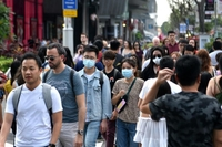 People are seen wearing masks as they walk down Orchard Road on Jan 26, 2020.ST PHOTO: KELLY HUI
