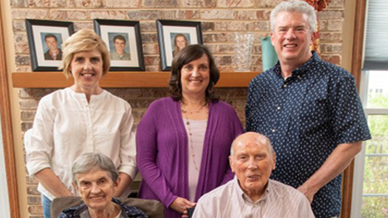 Denise Brown (center) with her siblings and parents, Sally and Roger Loeffler. MUST CREDIT: Denise Brown