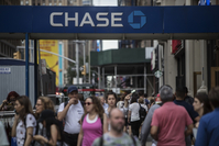 Pedestrians pass in front of a JPMorgan Chase bank branch in New York on July 2, 2019. MUST CREDIT: Bloomberg photo by Victor J. Blue.