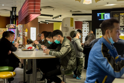 customers wear protective masks inside a McDonald's restaurant in Hong Kong on Jan. 29, 2020.. MUST CREDIT: Bloomberg photo by Paul Yeung.