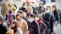 Tourists wearing face masks walk along a shopping street leading to the Sensoji temple in the Asakusa district of Tokyo on Jan. 28, 2020. MUST CREDIT: Bloomberg photo by Akio Kon.