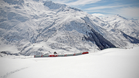 The Glacier express makes it's way across a snowy landscape. MUST CREDIT: Glacier Express AG.
