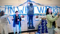 Supporters of Sen. Elizabeth Warren, D-Mass., decorate Roosevelt High School in Des Moines, Iowa, on Monday, Feb. 3, 2020. MUST CREDIT: Washington Post photo by Melina Mara