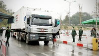 Photo: A truck carrying goods waits for clearance on Vietnam's border with China. Viet Nam News/ANN