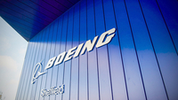 The Boeing logo hangs from an entrance to its factory in Sheffield, England, on Oct. 25, 2018. MUST CREDIT: Bloomberg photo by Matthew Lloyd.