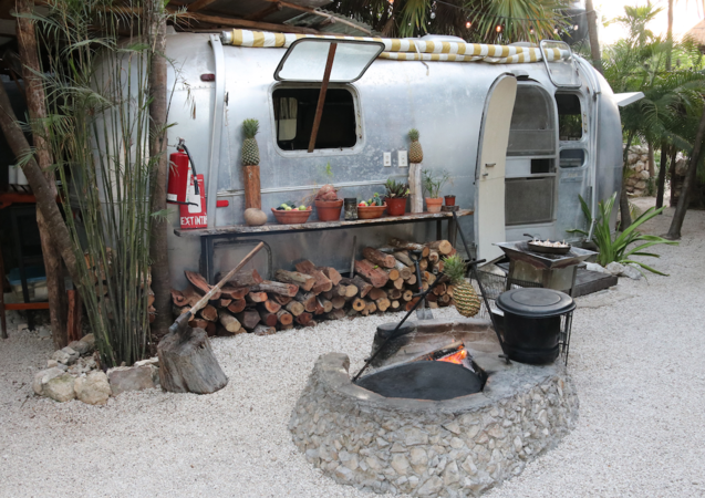 The Airstream-turned-kitchen and outdoor firepit at Safari Tulum in Tulum, Mexico. MUST CREDIT: Photo for The Washington Post by Nevin Martell