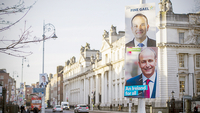 General election posters hang from a lamppost outside government buildings in Dublin on Feb. 6, 2020. MUST CREDIT: Bloomberg photo by Aidan Crawley.