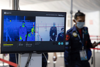 A monitor displays a thermographic image of attendees passing through a screening point at the Singapore Airshow in Singapore on Feb. 11, 2020. MUST CREDIT: Bloomberg photo by SeongJoon Cho.