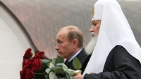 Russian President Vladimir Putin, left, and Russian Orthodox Church Patriarch Aleksy II, attend a commemoration ceremony for the victims of Soviet leader Joseph Stalin's reign of terror at the Church of the Resurrection and the Holy New Martyrs and Confessors of Russia, in Butovo, Russia, on Oct. 30, 2007. MUSTS CREDIT: Bloomberg photo by Alexei Boitsov.