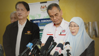 Deputy Prime Minister Datuk Seri Wan Azizah Wan Ismail speaking to the media as Health Minister Dr Dzulkefly Ahmad (centre) and Health director-general Datuk Noor Hisham Abdullah look on.