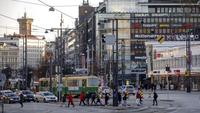 Pedestrians cross tramlines in Helsinki, Finland, on Feb. 6, 2020. MUST CREDIT: Bloomberg photo by Maija Astikainen.