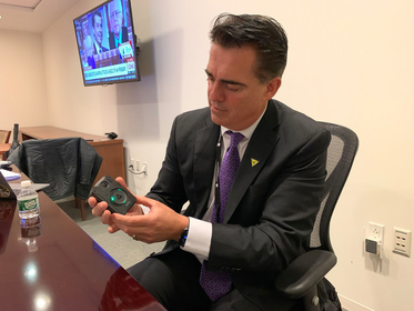 Rick Smith, founder and CEO of Axon, which makes most of the wearable cameras used by U.S. police departments, demonstrates the new Axon Body 3 camera. MUST CREDIT: Washington Post photo by Tom Jackman