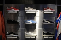 A range of Puma Suede Classic sneakers sit on display inside the Puma concept store in Herzogenaurach, Germany, on Feb. 19, 2020. MUST CREDIT: Bloomberg photo by Krisztian Bosi.