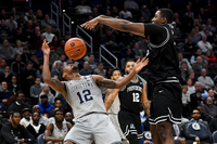 Providence's Kalif Young blocks the shot of Georgetown's Terrell Allen on Wednesday, Feb. 19, 2020. The Friars defeated the Hoyas, 73-63. MUST CREDIT: Washington Post photo by Katherine Frey