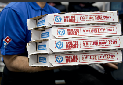 A employee moves pizza boxes before a delivery at a Domino's Pizza restaurant in Chantilly, Va., on Feb. 20, 2018. MUST CREDIT: Bloomberg photo by Andrew Harrer.