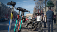 Tourists pose for photographs beside Dott and Bird Rides Inc.public hire scooters in Paris on Dec. 31, 2019. MUST CREDIT: Bloomberg photo by Anita Pouchard Serra.