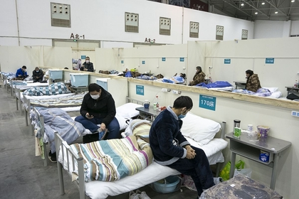 Patients are seen at a temporary hospital converted from