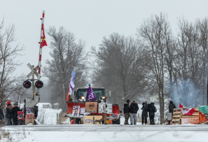 Demonstrators stand at a rail blockade, during a protest near Belleville, Ontario, Canada, on Feb. 13, 2020. MUST CREDIT: Bloomberg photo by Brett Gundlock.