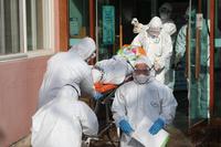 File Photo : Coronavirus infected patient in South Korea /The Korea Herald/ANN