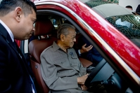 Mahathir Mohamad, Malaysia's prime minister, tests the newest national car in Kuala Lumpur, Malaysia, on June 22, 2018. MUST CREDIT: Bloomberg photo by Nadirah Zakariya