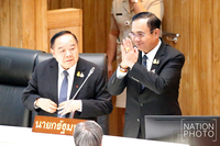 Prayut, right and Prawit.