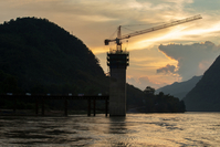 The Ban Ladhan Railway bridge, a section of the China-Laos Railway built by the China Railway Group Ltd., stands under construction on the Mekong River in Ban Ladhan, Luang Prabang province, Laos, on Oct. 18, 2018. MUST CREDIT: Bloomberg photo by Taylor Weidman.
