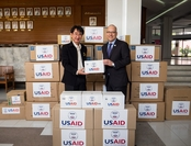 USAID Regional Development Mission for Asia Mission Director Peter A. Malnak, right, handed over personal protective equipment (PPE) to Dr. Tanarak Plipat, Deputy Director General, Department of Disease Control of Thailand Ministry of Public Health at a handover ceremony in Nonthaburi, Thailand