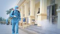 A medical worker sprays sanitiser at a collective quarantine area. — VNA/VNS Photo Dương Giang