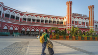 A traveller stands outside a nearly empty Delhi Junction Railway Station in Delhi on March 22, 2020. MUST CREDIT: Bloomberg photo by Prashanth Vishwanathan