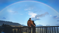 Overlooking the Pacific Ocean, Lisa Pezzino and Kit Center, of Oakland, gaze out at a rainbow over the mountains in Big Sur, Calif., after they migrated into nature to get away from the Bay Area during the worldwide coronavirus outbreak. MUST CREDIT: Washington Post photo by Melina Mara