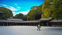 A pedestrian walks in the empty Meiji shrine in Tokyo on March 28, 2020. MUST CREDIT: Bloomberg photo by Noriko Hayashi.