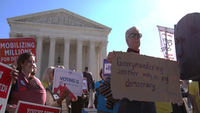 ctivists protest partisan gerrymandering in a scene from