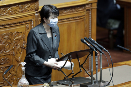 Sanae Takaichi, Japan's internal affairs minister, wearing a protective mask, speaks during a plenary session at the upper house of parliament in Tokyo on April 3, 2020. MUST CREDIT: Bloomberg photo by Kiyoshi Ota.