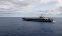 The USS Theodore Roosevelt is underway in the Philippine Sea during late March. MUST CREDIT: U.S. Navy handout photo by Specialist Seaman Jomark A. Almazan