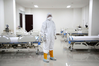 A medical worker stands in a treatment room at the COVID-19 emergency hospital in Kemayoran, Jakarta, on March 3. (Kompas/Pool/Heru Sri Kumoro)