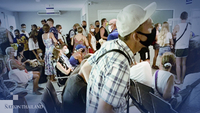 A picture taken on Friday evening shows a crowd of foreign nationals applying for visa extension at Koh Samui Immigration Office, which serves both tourists in Koh Samui and Koh Phangan.