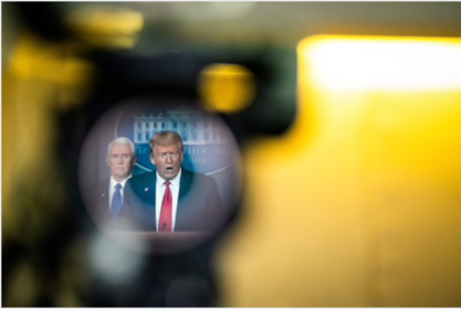 President Trump, reflected in a television camera, speaks with his coronavirus task force at a White House briefing on March 18., 2020. MUST CREDIT: Washington Post photo by Jabin Botsford.