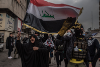 Iraqi protesters march toward Khilani Square in Baghdad in January. MUST CREDIT: photo for The Washingotn Post by Emilienne Malfatto.