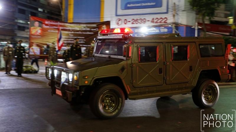 Military joins police to enforce nationwide curfew on Saturday night. Photo taken in Bangkok by Korbphuk Phromrelha, The Nation.