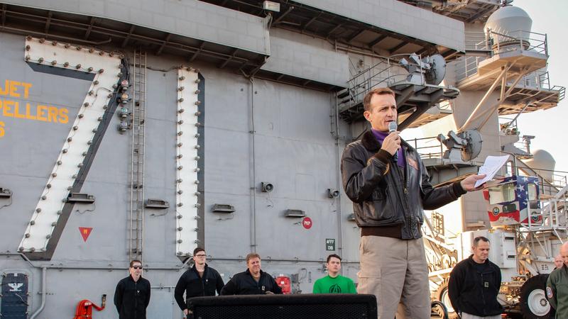 Capt. Brett Crozier, commanding officer of the aircraft carrier USS Theodore Roosevelt (CVN 71), gives remarks during an all-hands call on the ship's flight deck Dec. 15, 2019. PHOTO CREDIT: U.S. Navy handout photo by Mass Communication Specialist Seaman Alexander Williams