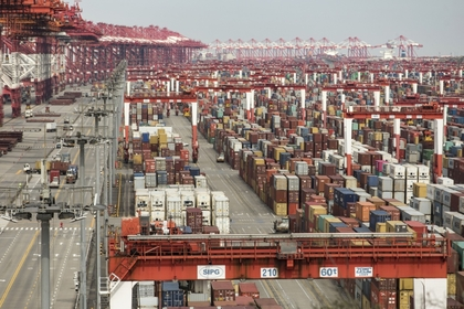 Shipping containers stacked March 23, 2020, at the Yangshan Deepwater Port in Shanghai. Bloomberg photo by Qilai Shen