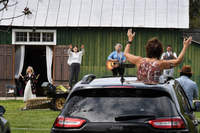 Sharon Glasgow, left, worships with others during a drive-in style Easter church service at the Glasgow Farm in Fredericksburg, Virginia. The farm, which is usually a wedding venue, has been holding the drive-in church services due to the guidelines on gathering in groups because of the coronavirus. MUST CREDIT: Washington Post photo by Matt McClain