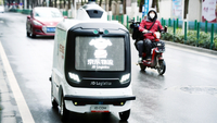 A JD automated delivery vehicle is seen on a street in Wuhan, capital of Hubei province, on Feb 7,2020. [ZHU XINGXIN/CHINA DAILY]