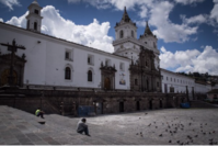 Pedestrians sit outside of the closed San Francisco Church on Palm Sunday in Quito, Ecuador on April 5, 2020. MUST CREDIT: Bloomberg photo by Johis Alarcon.