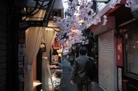 A pedestrian walks past shuttered stores in the Shinjuku district of Tokyo, Japan, on April 4. MUST CREDIT: Soichiro Koriyama/Bloomberg