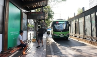 A bus stop in HCM City's District 1. Public buses, taxis and service transport vehicles under nine seats will continue to be suspended until April 22. — VNS Photo Nguyễn Diệp