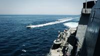 Iranian Revolutionary Guard vessels sail close to the USS Paul Hamilton in the north Arabian Gulf. on April 15. MUST CREDIT: U.S. Navy handout photo Photo by: U.S. Navy — Handout Location: Arabian Gulf